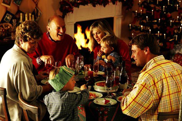 Family eating Christmas dinner natale